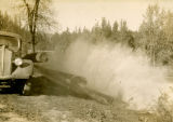 Dumping logs into Rock Creek, Skamania County, Washington