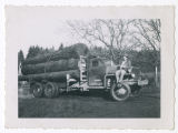 Bill Fehr with K.W. Peterson logging truck in La Center, Washington in 1947