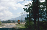 Cascade Drive with curve sign and directions to Old North Bonneville in background