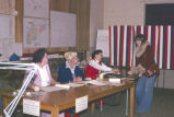 Election officials and voter at city hall in old North Bonneville