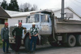 North Bonneville citizens standing beside a dump truck