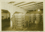 Warren Packing, stacks of tins, 1910