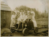 Group portrait on railroad cart