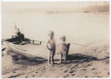 Children standing next to boat, Mutiny Bay, Whidbey Island, Washington