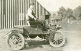 Willis Anson Evans and his Oldsmobile, Rock Lake, Washington, circa 1910