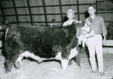 Bob Morton with Grand Champion fat steer, Palouse Empire Fair, Mockonema, Washington, 1959
