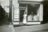 Dorothy Eisinger in front of Modern Maid Ice Cream Store